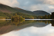 Sunset over Loch an Eilein and castle island, Cairngorms National Park, Scottish Highlands, Uk