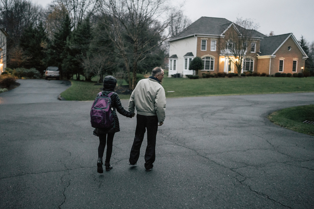 Jared Taylor, editor of the white nationalist publication American Renaissance and a member of the so-called alt-right, a far-right fringe movement that embraces white nationalism and a range of racist and anti-immigrant positions, walks his daughter to the bus stop in Virginia on Dec. 5, 2016.