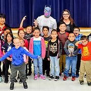 WWE Superstar Sin Cara reading to the elementary students at Bonham Elementary School, El Paso Texas , November 2, 2018