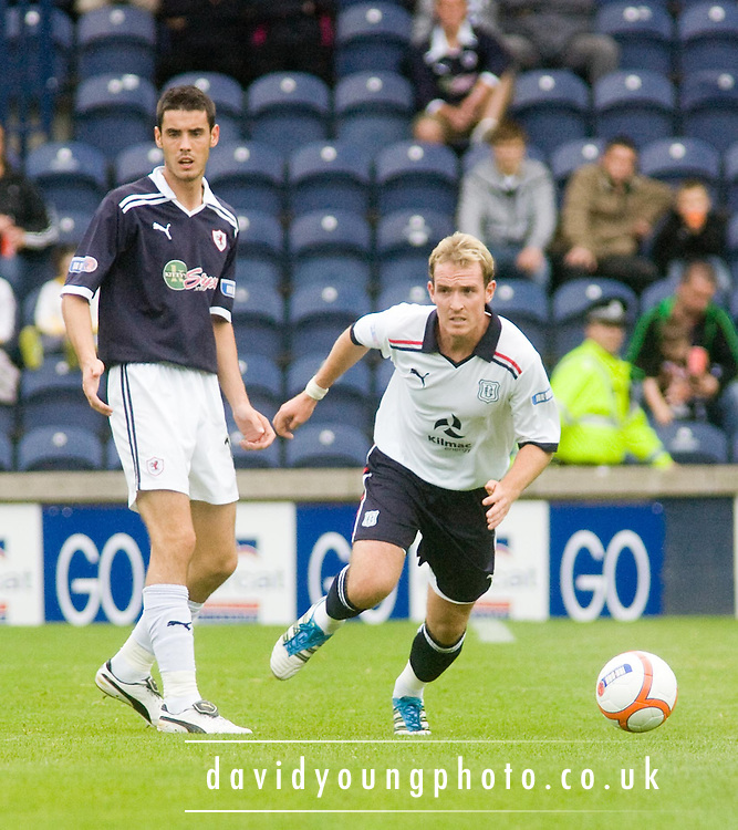 Dundee's Gary irvine races away from Raith Rovers' Brian Graham - Raith Rovers v Dundee, IRN BRU Scottish Football League First Division..© David Young.5 Foundry Place .Monifieth.DD5 4BB.07765252616.email: davidyoungphoto@gmail.com.http://www.davidyoungphoto.co.uk