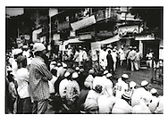 """Sign reads: """"Islam is not Terrorism"""".  Muslim worshippers overflow onto Mumbai street as they pray for peace to commemorate the Mumbai train bombings are believed to be perpetuated by an extremist Muslim group.  One month earlier, terrorists (probably affiliated to a Kashmiri group, Lashkar e Toiba, LeT) planted bombs on commuter trains which exploded almost simultaneously at rush hour killing over 200 and wounding 700."""