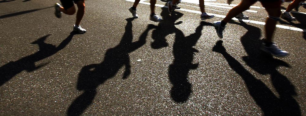 The pack of runners cast shadows in the evening sun during the 2007 Greifenseelauf half marathon around the lake Greifensee with start and finish in Uster, Switzerland, Saturday, Sept. 22, 2007. (Photo by Patrick B. Kraemer / MAGICPBK)