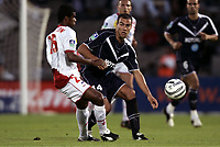 FOOTBALL - FRENCH CHAMPIONSHIP 2005/2006 - GIRONDINS BORDEAUX v AS NANCY LORRAINE - 06/08/2006 - BRUNO CHEYROU (BOR) / ADAILTON (NAN) - PHOTO GUY JEFFROY / DIGITALSPORT<br />
