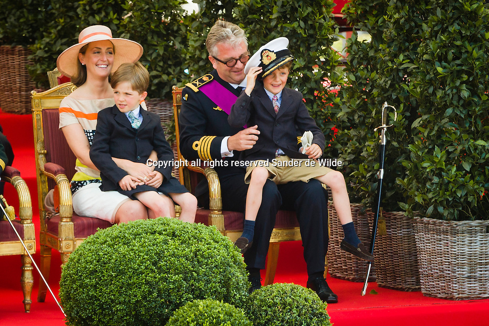Belgiums National Day  in Brussels July 21, 2012. Belgium celebrates its national day and its 182nd anniversary of independence on this Saturday with a military parade in front of the Royal Palace. Prince Nicolas got the attention with his fathers hat. From left to right princess Clair and Prince Laurent with their children Nicolas and Aymeric, Nicolas is trying fathers hat.