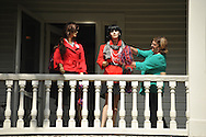 Beth Doty decorates mannequins that she puts on the balcony of her house, in Oxford, Miss. on Thursday, October 4, 2012.