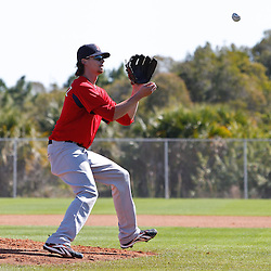 February 19, 2011; Fort Myers, FL, USA; Boston Red Sox starting pitcher Clay Buchholz (11) fields the ball in a drill during spring training at the Player Development Complex.  Mandatory Credit: Derick E. Hingle