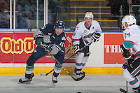 KELOWNA, CANADA - APRIL 22: Joe Gatenby #28 of Kelowna Rockets checks Andreas Schumacher #15 of Seattle Thunderbirds as he passes the puck on April 22, 2016 at Prospera Place in Kelowna, British Columbia, Canada.  (Photo by Marissa Baecker/Shoot the Breeze)  *** Local Caption *** Joe Gatenby; Andreas Schumacher;