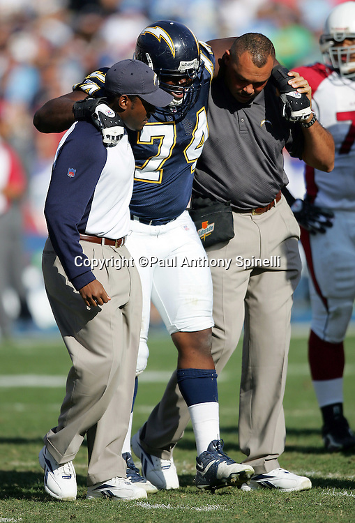 SAN DIEGO - DECEMBER 31:  Defensive end Jacques Cesaire #74 of the San Diego Chargers gets helped off the field after an injury during the game against the Arizona Cardinals at Qualcomm Stadium on December 31, 2006 in San Diego, California. The Chargers defeated the Cardinals 27-20 to secure the number one seed in the AFC playoffs. ©Paul Anthony Spinelli *** Local Caption *** Jacques Cesaire