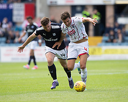 Dundee's Mark O'Hara and Ross County's Christopher Routis. Dundee 1 v 2 Ross County, Scottish Premiership game played 5/8/2017 at Dundee's home ground Dens Park.