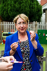 Pictured: Annabelle Ewing enjoys her reward of a chocolate after enduring the taste test.<br /> <br /> Community safety minister, Annabelle Ewing MSP joined staff, parents and children at Bright Sparks Nursery in Edinburgh to sample Bitrex, the most bitter substance in the world. Britex can be added to products, such as liquitabs, to protect small children. The visit was also to raise awareness of Child Safety Week.  <br /> Ger Harley | EEm 8 June 2016