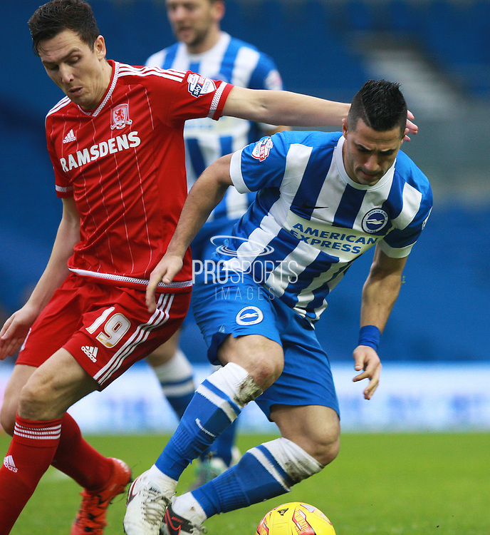 Brighton central midfielder Beram Kayal gets the better of Middlesbrough FC midfielder Stewart Downing during the Sky Bet Championship match between Brighton and Hove Albion and Middlesbrough at the American Express Community Stadium, Brighton and Hove, England on 19 December 2015. Photo by Bennett Dean.