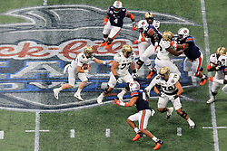 UCF Knights quarterback McKenzie Milton (10) runs the ball during the 2018 Chick-fil-A Peach Bowl NCAA football game on Monday, January 1, 2018 in Atlanta. (Daniel Shirey / Abell Images for the Chick-fil-A Peach Bowl)