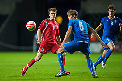 SWANSEA, ENGLAND - Friday, September 4, 2009: Wales' Aaron Ramsey and Italy's Gabriele Angella during the UEFA Under 21 Championship Qualifying Group 3 match at the Liberty Stadium. (Photo by David Rawcliffe/Propaganda)