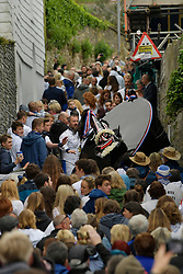 © Licensed to London News Pictures. 01/05/2017 May Day celebrations in Padstow Cornwall. The Blue Oss and the Red Osds lead the traditional May Day celebrations around the historic harbour of Padstow in Cornwall.<br /> Despite the rain large crowds attended the annual event.Photo credit : MARK HEMSWORTH/LNP