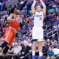 24 March 2014: Los Angeles Clippers forward Blake Griffin (32) takes a jump shot during the Los Angeles Clippers 106-98 victory over the Milwaukee Bucks at the Staples Center, Los Angeles, California, USA.