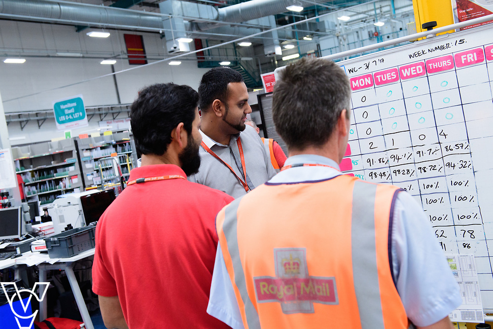 Two delivery offices, Oadby and Leicester South, which are both based inside the Leicester Mail Processing Unit building, have passed the penultimate gateway of One Plan.  One Plan is a business programme designed to have a standardised operation of excellence.  Pictured is Shahbaaz Khan, centre, working with, from left, Shuaib Chowdhury and Ian Rosewarne.<br /> <br /> Picture: Chris Vaughan Photography<br /> Date: July 7, 2017
