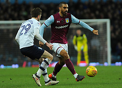 Lewis Grabban of Aston Villa under pressure from Tom Barkhuizen of Preston North End - Mandatory by-line: Nizaam Jones/JMP - 20/02/2018 - FOOTBALL - Villa Park - Birmingham, England - Aston Villa v Preston North End- Sky Bet Championship