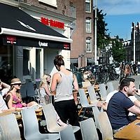 Nederland, Amsterdam , 19 juli 2010..Het zonnige terras van cafe Brandstof op de hoek Marnixstraat Rozengracht.The sunniest terraces of Amsterdam