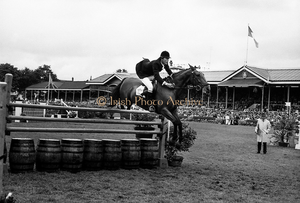 Show-jumper Eddie Macken takes a fence with at the RDS with his usual grace.<br /> 05/08/1971