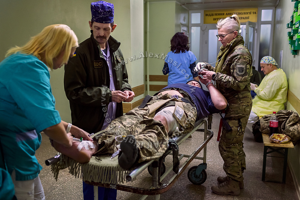 Julia Paevska is checking the heartbeat of a solder that fell on a sharp glass and wounded his left leg, inside the hospital in Bakhmut, a town in eastern Ukraine's conflict zone.