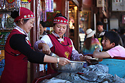 Delivering dried yak meat to one of the many shops in old-town Lijiang, Yunnan, China; September, 2013.