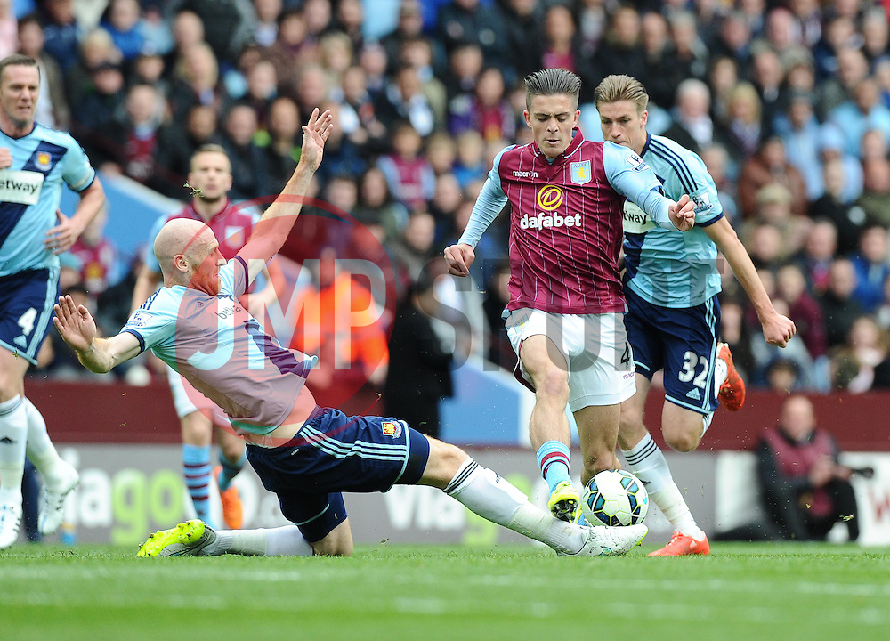 West Ham United's James Collins tackles Aston Villa's Jack Grealish  - Photo mandatory by-line: Joe Meredith/JMP - Mobile: 07966 386802 - 09/05/2015 - SPORT - Football - Birmingham - Villa Park - Aston Villa v West Ham United - Barclays Premier League