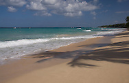 Palm tree shadows on the sand in Alleynes Bay on the West Coast of Barbados