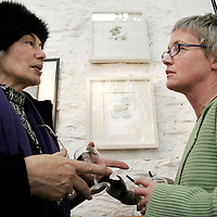 Laura Vecchi-Ford and Dorothy Ledwith discuss Dorothy's work at the Clare Printmakers exhibition in the Russell Gallery in New Quay on Saturday evening.<br /> <br /> Photograph by Yvonne Vaughan.