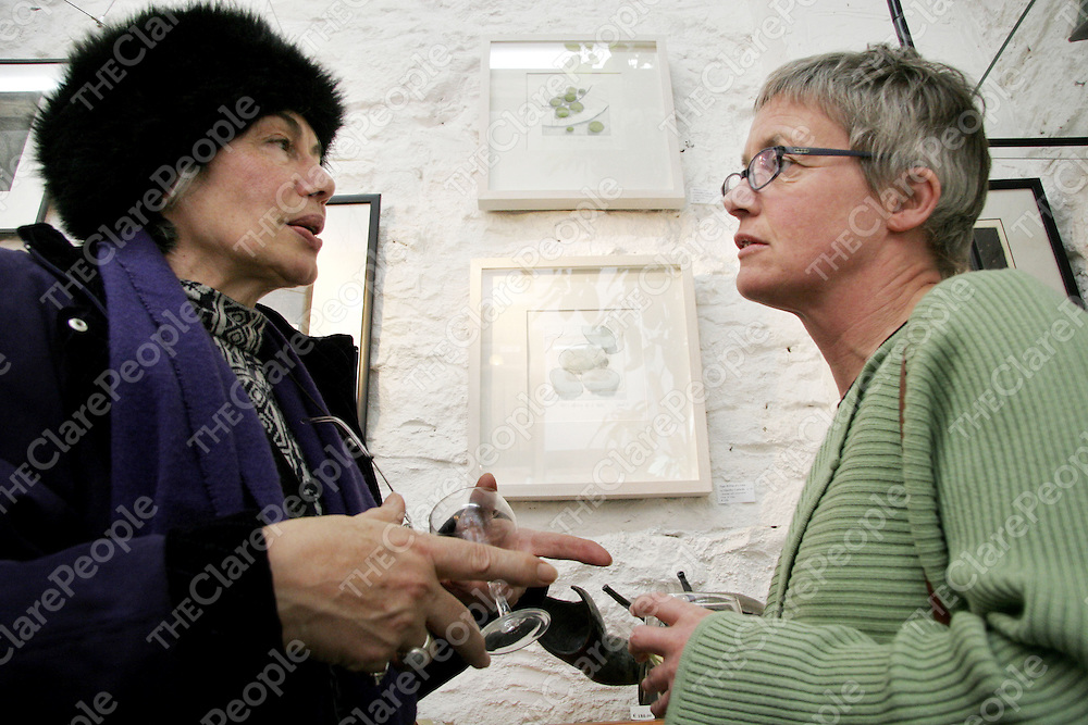 Laura Vecchi-Ford and Dorothy Ledwith discuss Dorothy's work at the Clare Printmakers exhibition in the Russell Gallery in New Quay on Saturday evening.<br />