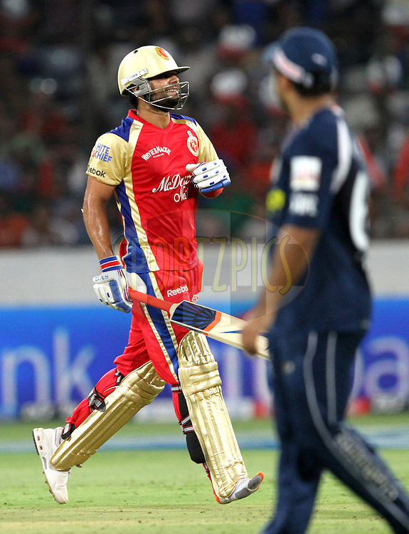 Virat Kohali takes a run without a shoe in right leg during match 11 of the Indian Premier League ( IPL ) between the Deccan Chargers and the Royal Challengers Bangalore held at the Rajiv Gandhi International Cricket Stadium in Hyderabad on the 14th April 2011..Photo by Prashant Bhoot/BCCI/SPORTZPICS.