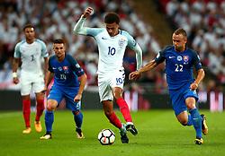 Dele Alli of England goes past Stanislav Lobotka of Slovakia - Mandatory by-line: Robbie Stephenson/JMP - 04/09/2017 - FOOTBALL - Wembley Stadium - London, United Kingdom - England v Slovakia - 2018 FIFA World Cup Qualifier