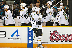 December 13, 2010; San Jose, CA, USA;  Dallas Stars left wing Jamie Benn (14) celebrates with teammates after scoring a goal against the San Jose Sharks during the first period at HP Pavilion. Mandatory Credit: Jason O. Watson / US PRESSWIRE