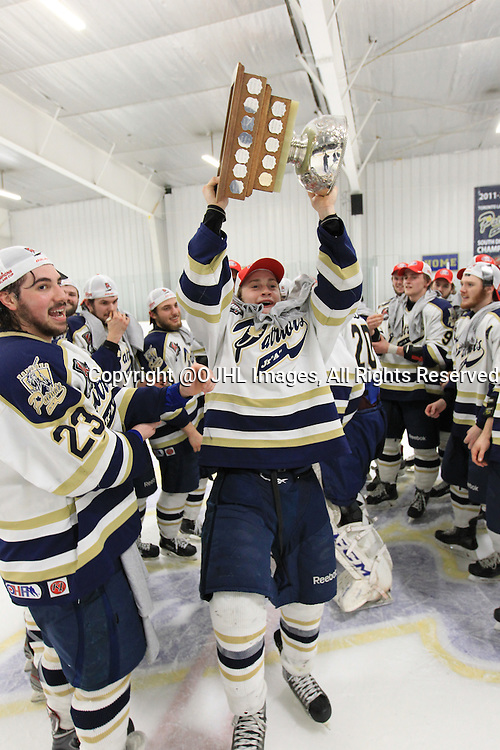 TORONTO, ON - Apr 22, 2015 : Ontario Junior Hockey League game action between the Toronto Patriots and the Kingston Voyageurs. Game seven of the Buckland Cup Championship Series. Toronto Patriots players raise the cup.<br /> (Photo by Tim Bates / OJHL Images)