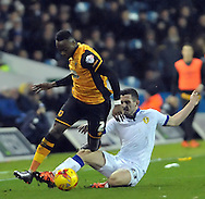 Lewis Cook of Leeds United fouls Moses Odubajo of Hull City during the Sky Bet Championship match at Elland Road, Leeds<br /> Picture by Graham Crowther/Focus Images Ltd +44 7763 140036<br /> 05/12/2015