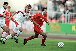MINSK, BELARUS - Saturday, September 4, 1999: Wales's Ryan Giggs and Belarus's Aleksamdr Lukhvich battle for the ball during the UEFA Euro 2000 Qualifying Group One match at the Dinamo Stadium. (Mandatory credit: David Rawcliffe/Propaganda)