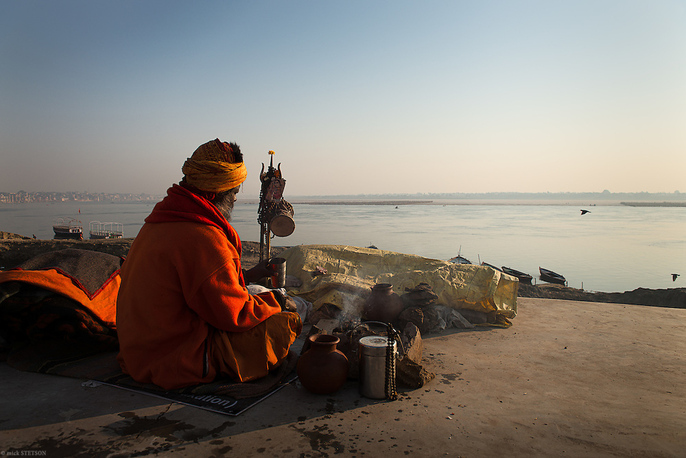 — In the aftermath of the Kumbha Mela upstream, sadhus line the shores of the holy Ganga (Ganges) river in nearby Varanasi before returning to their asrams in northern India. In the Hindu psyche, the river is a goddess, representing spiritual wisdom and knowledge. Bathing in her waters, cleanses both the body and the spirit.