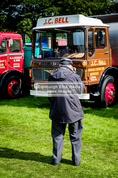 The 44th Biggar Vintage Vehicle Rally held in Biggar on 13th August 2017.  An enthusiast photographing a vintage vehicle.<br /> <br /> (c) Andrew Wilson | Edinburgh Elite media