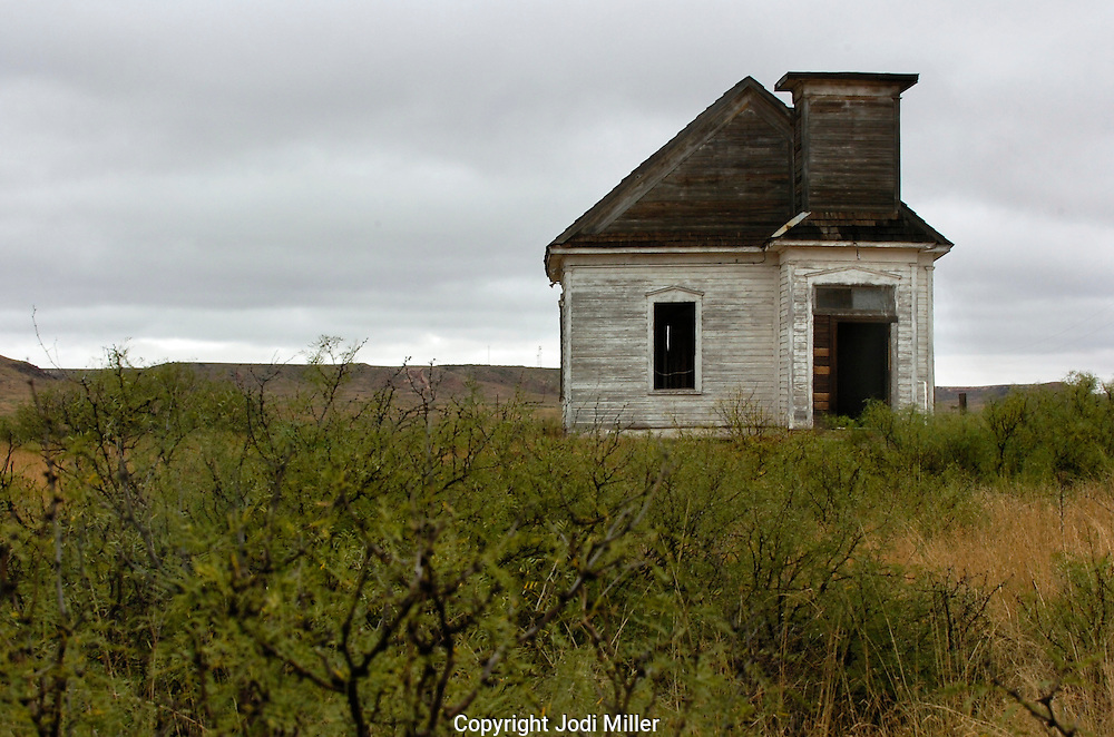 A run down church in the desert of New Mexico.