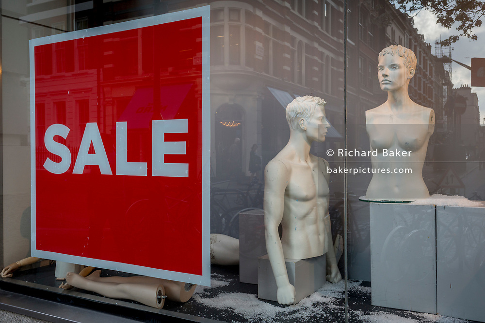 Disjointed mannequins in the window of an outdoor retailer with a Sale, on 28th March, 2017, in London, England.