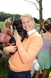 SOPHIA THOMPSON and her dog INCA at the Macmillan Cancer Relief Dog Day held at the Royal Hospital Chelsea South Grounds, London on 6th July 2004.
