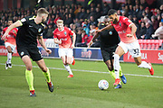 Salford City forward Jake Jervis challenged by the opponent during the EFL Sky Bet League 2 match between Salford City and Macclesfield Town at the Peninsula Stadium, Salford, United Kingdom on 23 November 2019.