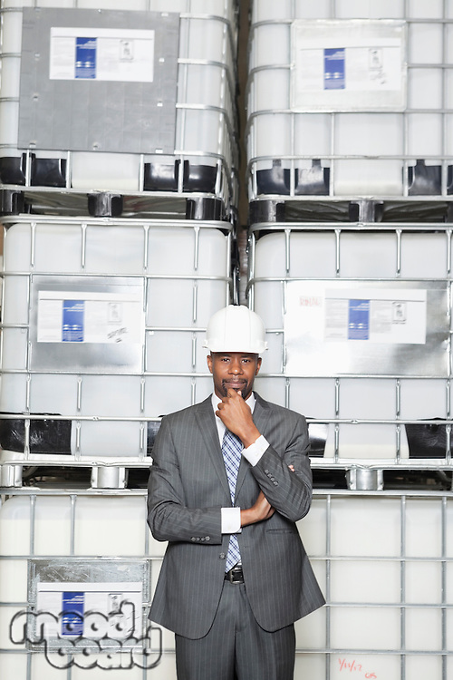 Confident African American male contractor standing in manufacturing industry