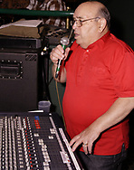 Jerry Gillotti makes an announcement from the soundboard at Gilly's Niteclub in Dayton, Friday, May 11th.
