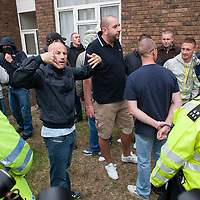 LONDON, ENGLAND - SEPTEMBER 11: English Defence League supporters are protected by police before asking to be escorted away in police vans. Anti-fascist demonstrators and local muslim youths gathered to counter the threatened march by right-wing groups outside Harrow Central Mosque. London....