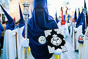 Capes and religious icons in the Semana Santa parade during Holy Week in Cadiz, Spain