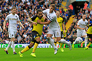 Burton Albion striker Sean Scannell (9) and Leeds United defender Liam Cooper (6) battle for the ball during the EFL Sky Bet Championship match between Leeds United and Burton Albion at Elland Road, Leeds, England on 9 September 2017. Photo by Richard Holmes.