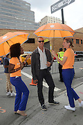 Fashion photographer Nigel Barker -  with AccuWeather MinuteCast street team members outside Clarkson Square during New York Fashion Week