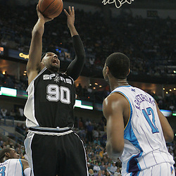 29 March 2009: San Antonio Spurs center Drew Gooden (90) shoots over New Orleans Hornets center Hilton Armstrong (12) during a 90-86 victory by the New Orleans Hornets over Southwestern Division rivals the San Antonio Spurs at the New Orleans Arena in New Orleans, Louisiana.
