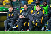 (LtoR) Assistant manager of Celtic FC, Damien Duff, Assistant manager of Celtic FC, John Kennedy and Manager of Celtic FC, Neil Lennon on the bench during the Ladbrokes Scottish Premiership match between Livingston FC and Celtic FC at The Tony Macaroni Arena, Livingston, Scotland on 6 October 2019.