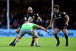 Olly Woodburn of Exeter Chiefs is challenged by Tom Lawday of Harlequins - Mandatory by-line: Ryan Hiscott/JMP - 19/10/2019 - RUGBY - Sandy Park - Exeter, England - Exeter Chiefs v Harlequins - Gallagher Premiership Rugby